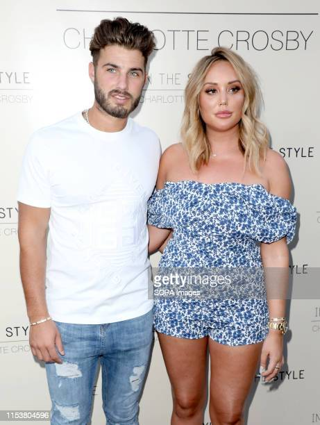 Joshua Ritchie and Charlotte Crosby attend the Charlotte Crosby In The Style Party at Nikki's Bar in London