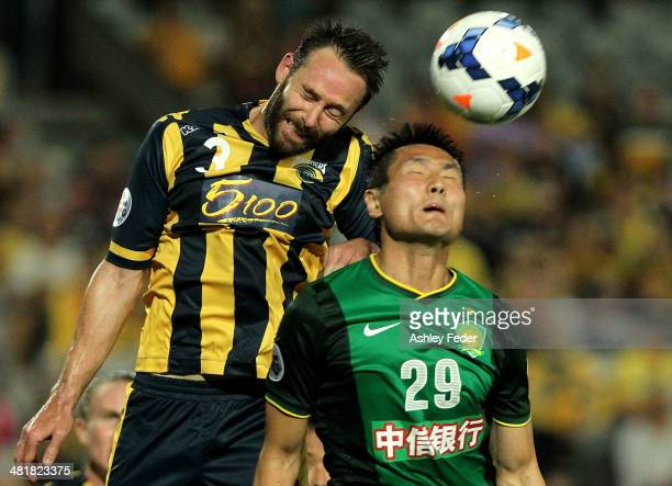 Joshua Rose of the Mariners contests the header against Shao Jiayi of Beijing Guoan during the Asian Champions League match between the Central Coast...