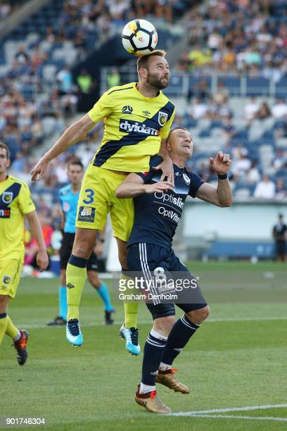 Joshua Rose of the Mariners heads over Besart Berisha of the Victory during the round 14 ALeague match between the Melbourne Victory and the Central...