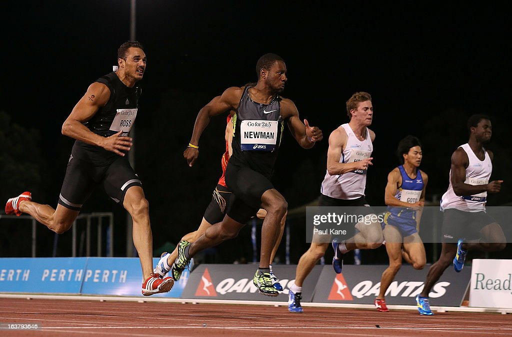 Joshua Ross of Australia and Calesio Newman of the USA compete in the mens open 100 metre race during the Perth Track Classic at the WA Athletics Stadium on March 16, 2013 in Perth, Australia.