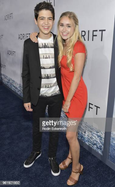 Joshua Rush and Emily Skinner arrive at the premiere of STX Films' Adrift at Regal LA Live Stadium 14 on May 23 2018 in Los Angeles California