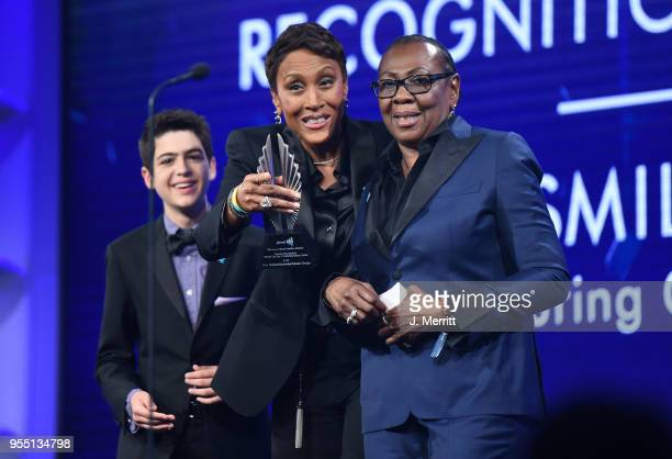 Joshua Rush and Robin Roberts present Gloria Carter with a Special Recognition Award onstage during the 29th Annual GLAAD Media Awards at The Hilton...