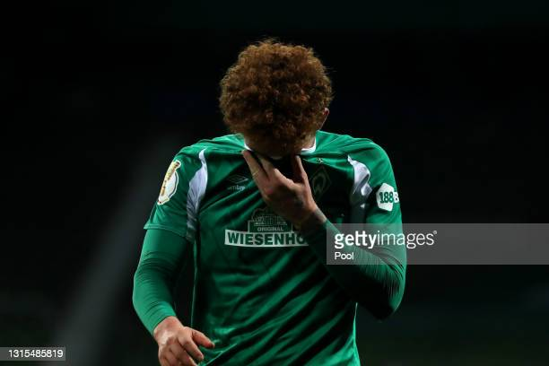 Joshua Sargent of SV Werder Bremen looks dejected following his team's defeat in the DFB Cup semi final match between Werder Bremen and RB Leipzig at...
