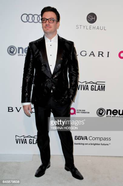 US Joshua Scott Chasez composer poses upon his arrival for the 25th annual Elton John AIDS Foundation's Academy Awards Viewing Party on February 26...