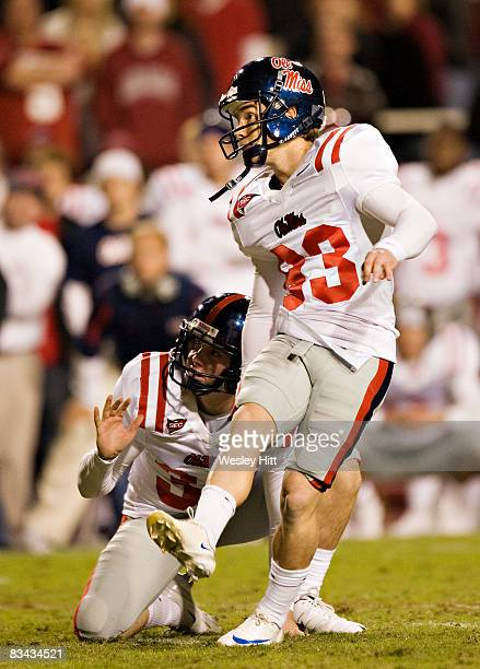 Joshua Shene of the Ole Miss Rebels kicks a field goal to seal the victory against the Arkansas Razorbacks at Donald W Reynolds Stadium on October 25...