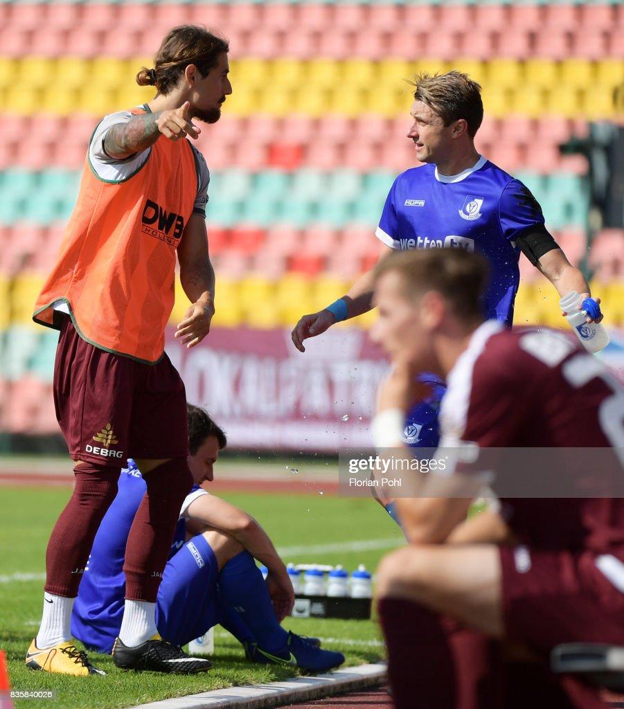 Joshua Silva of BFC Dynamo and Bjoern Brunnemann of VSG Altglienicke after the game between BFC Dynamo Berlin and VSG Altglienicke on august 20, 2017 in Berlin, Germany.