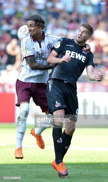 Joshua Silva of BFC Dynamo and Simon Terodde of FC Koeln battle for the ball during the DFB Cup first round match between BFC Dynamo and 1 FC Koeln...
