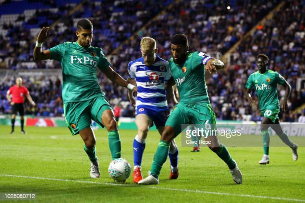 Joshua Sims of Reading battles with Adam Masina and Adrian Mariappa of Watford during the Carabao Cup Second Round match between Reading and Watford...