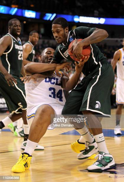 Joshua Smith of the UCLA Bruins and Durrell Summers of the Michigan State Spartans fight for the ball which results in a jumpball in the second half...