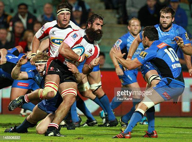 Joshua Strauss of the Lions looks to break from a tackle by David Pocock of the Force during the round 14 Super Rugby match between the Western Force...
