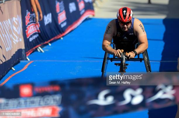 Joshua Sweeney finishes in first place in the Male PTWC division during the Legacy Triathlon-USA Paratriathlon National Championships on July 20,...