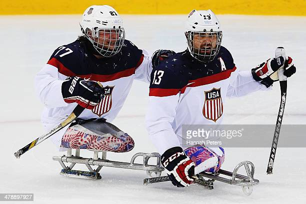 Joshua Sweeney of the USA celebrates with Joshua Pauls of the USA after scoring a goal during the ice sledge hockey gold medal game between the...
