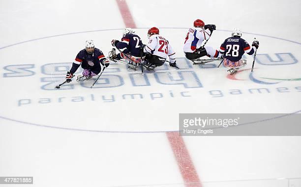 Joshua Sweeney of USA comes away with the puck at the start of the Ice Sledge Hockey Preliminary Round Group B match between USA and Russia at the...