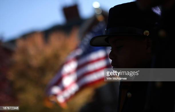 Joshua Terry dressed in a Civil War military uniform participates in a wreathlaying ceremony commemorating Veterans Day and honoring the Tuskegee...