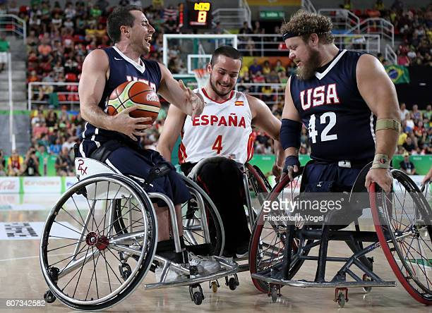Joshua Turek and Aaron Gouge of USA and Daniel Stix of Spain in action during Men's Wheelchair Basketball Gold Medal match between Spain and USA on...