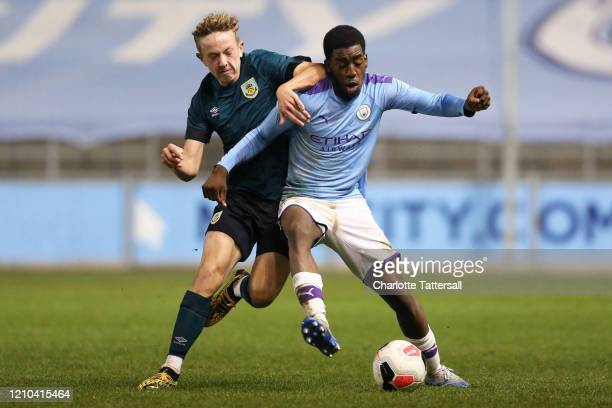 Joshua Wilson-Esbrand of Manchester City on the ball with Michael Mellon of Burnley during the FA Youth Cup match between Manchester City and Burnley...