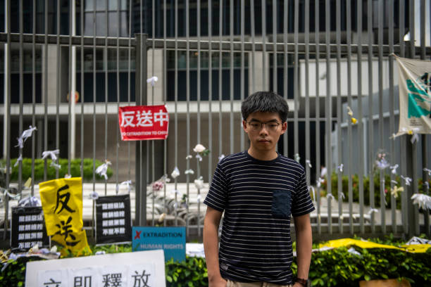 HKG: Hong Kong Joshua Wong Pose For Photo Outside Government Office