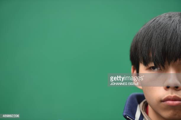 Joshua Wong, the teenage face of Hong Kong's pro-democracy movement, looks on before speaking at the movement's main protest site in the Admiralty...
