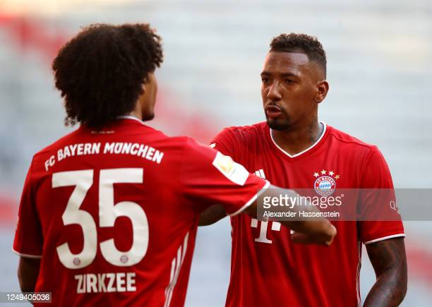 Joshua Zirkzee celebrates his sides first goal with Jerome Boateng of Bayern Munich during the Bundesliga match between FC Bayern Muenchen and...