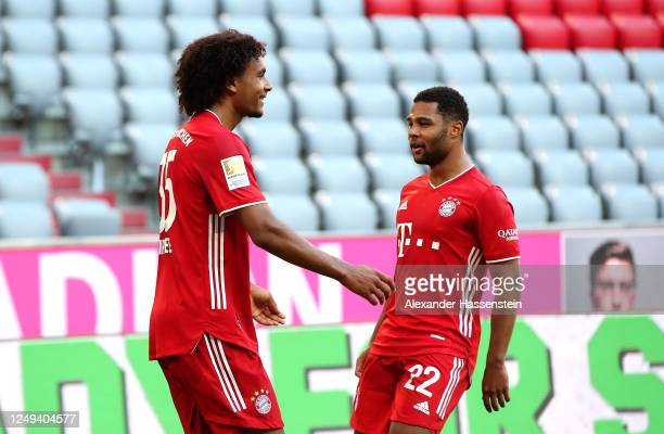 Joshua Zirkzee celebrates with Serge Gnabry of Bayern Munich after his sides first goal during the Bundesliga match between FC Bayern Muenchen and...
