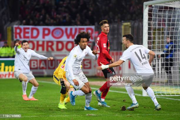 Joshua Zirkzee of Bayern Munich celebrates with team-mates after scoring his team's second goal during the Bundesliga match between Sport-Club...