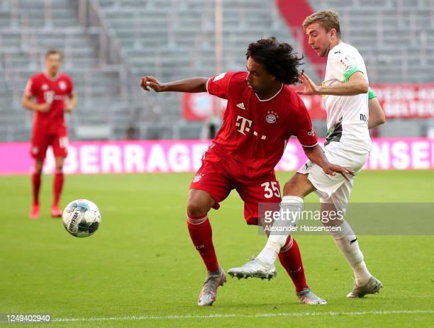 Joshua Zirkzee of Bayern Munich is challenged by Christoph Kramer of Borussia Monchengladbach during the Bundesliga match between FC Bayern Muenchen...