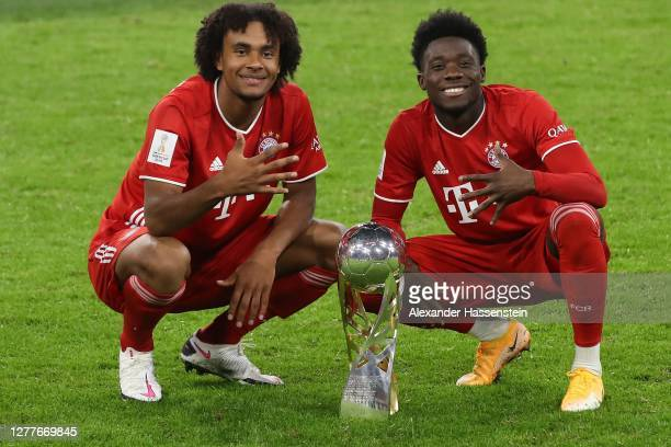 Joshua Zirkzee of FC Bayern Muenchen celebrates with his team mate Alphonos Davies after the Supercup 2020 match between FC Bayern München and...