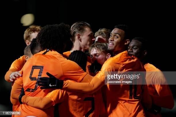 Joshua Zirkzee of Holland U19 celebrate his goal the 10 with Arjen van der Heide of Holland U19 Ryan Gravenberch of Holland U19 during the U19 Men...