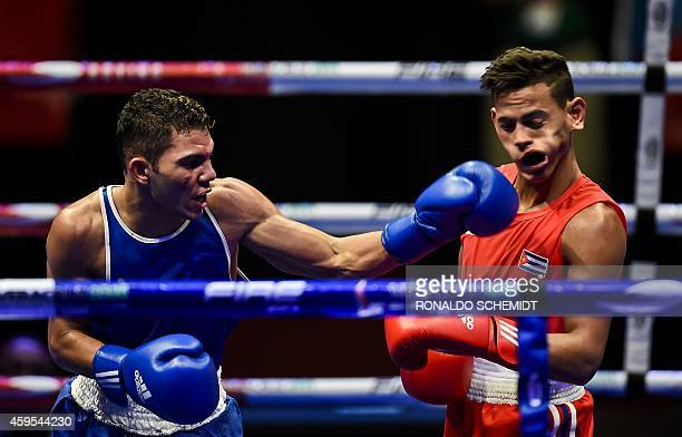 Joshuantony Ortiz of Puerto Rico connects against Robeisy Ramirez of Cuba during the qualification round of the 56 kg boxing competition at the XXII...