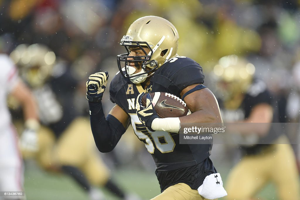Josiah Powell #48 of the Navy Midshipmen runs back an interception for a touchdown in the third quarter during a football game against the Houston Cougars at Navy-Marines Memorial Stadium on October 8, 2016 in Annapolis, Maryland.