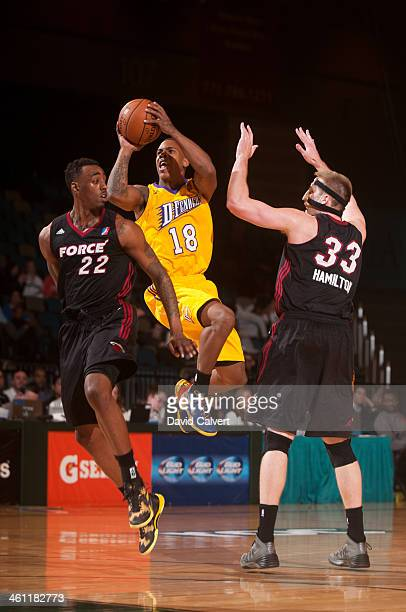 Josiah Turner of the Los Angeles D-Fenders shoots between Anthony Mason and Justin Hamilton of the Sioux Falls Skyforce during the 2014 NBA D-League...