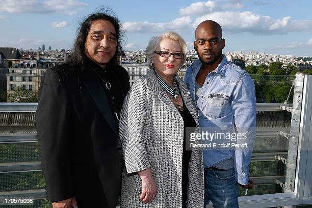 Josiane Balasko bstanding between her husband George Aguilar and her son Rudy Berry - Actress Josiane Balasko receives the Medal of Arts and Letters...