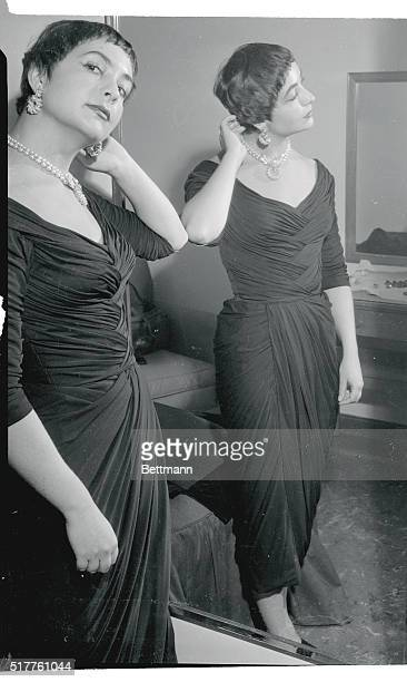 Josiane Mariani Berenger 19 year old fiancee of actor Marlon Brando is shown as she tried on an American dress she wore at her first television...