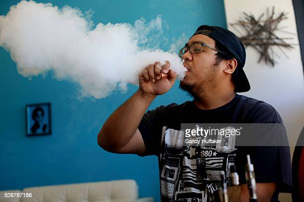 Josias Surla exhales vapor after taking a puff on an Electronic Cigarette at Sky City Vapor in San Diego California on Friday May 2 2014 A study to...