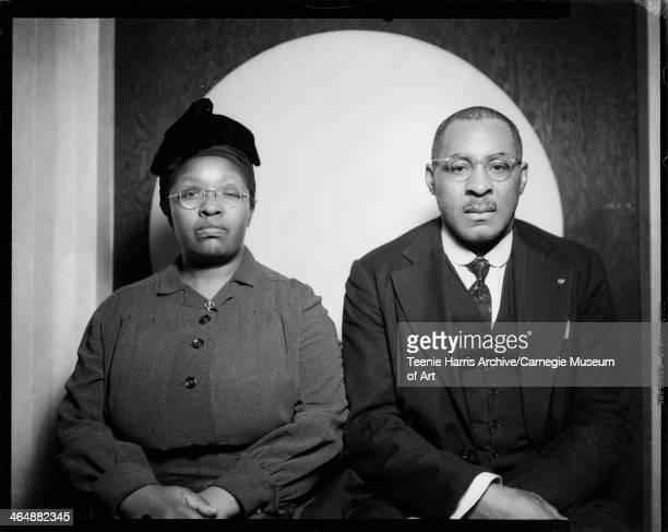 Josie Caldwell and Samuel Caldwell posed in front of circular background in Harris Studio Pittsburgh Pennsylvania 1945