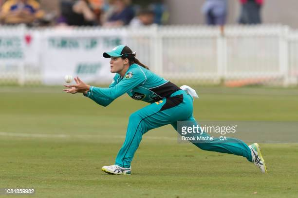 Josie Dooley of the Brisbane Heat takes a diving catch to dismiss Rachael Haynes of the Sydney Thunder during the Women's Big Bash League Semi Finals...