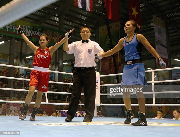 Josie Gabuco of the Philippines celebrates after defeating Beatrix Suguro of Indonesia during the women's 4548kg boxing final at the Wunna Theikdi...