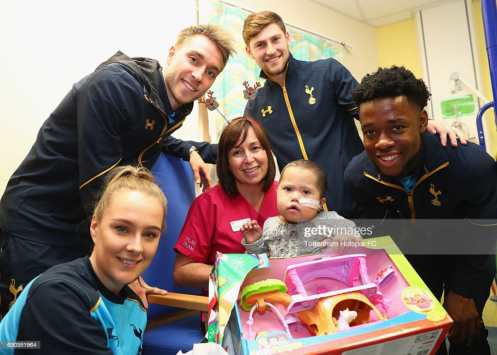 Josie Green, Christian Eriksen, Ben Davies and Josh Onomah of Tottenham Hotspur deliver Christmas presents to Children at Barnet Hospital on December 21, 2016 in London, England.