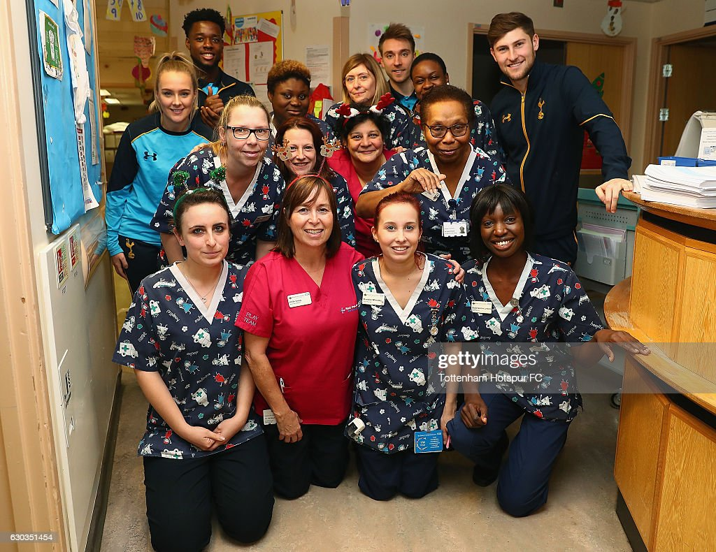 Josie Green, Josh Onomah, Christian Eriksen and Ben Davies of Tottenham Hotspur deliver Christmas presents to Children at Barnet Hospital on December 21, 2016 in London, England.