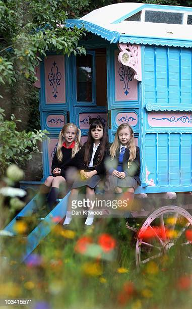 Josie Griffiths 10 Adrianna Bertola 11 and Kerry Ingram 11 pose for pictures at the home of the late author Roald Dahl on August 17 2010 in Great...
