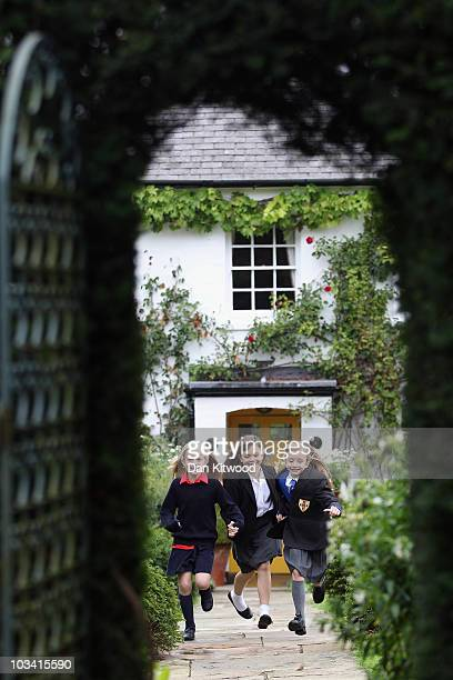 Josie Griffiths 10 Adrianna Bertola 11 and Kerry Ingram 11 pose for pictures outside Gipsey House the home of the late author Roald Dahl on August 17...
