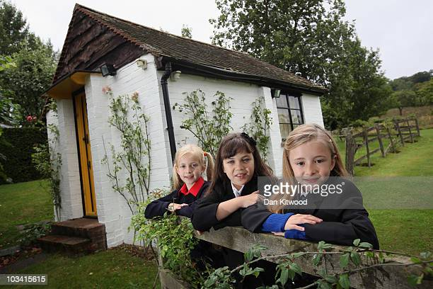 Josie Griffiths 10 Adrianna Bertola 11 and Kerry Ingram 11 pose for pictures outside the writing hut of the late author Roald Dahl on August 17 2010...