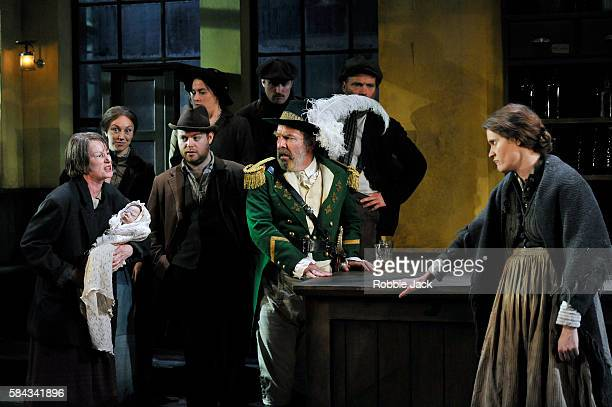 Josie Walker as Mrs Gogan Lloyd Hutchinson as Peter Flynn and Justine Mitchell as Bessie Burgess with artists of the company in Seán O'Casey's The...