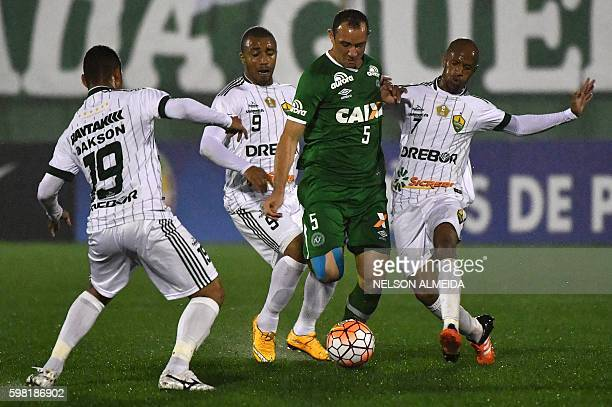 Josimar of Brazil's Chapecoense vies for the ball with Tiago Amaral and Leo Salino of Brazil's Cuiaba during their 2016 Copa Sudamericana football...