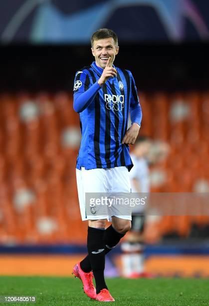 Josip Atalanta's Slovenian midfielder Josip Ilicic celebrates after scoring a goal during the UEFA Champions League round of 16 second leg match...