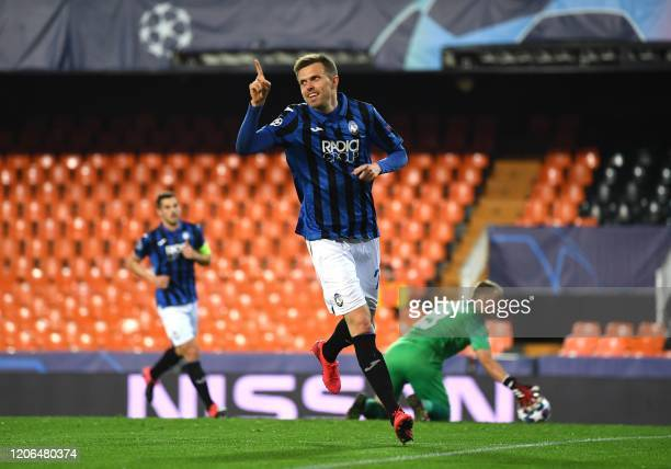 Josip Atalanta's Slovenian midfielder Josip Ilicic celebrates after scoring during the UEFA Champions League round of 16 second leg match between...