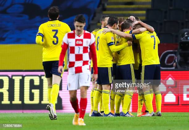 Josip Brekalo of Croatia shows his dejection as Dejan Kulusevski of Sweden celebrates with his team mates after scoring his team's first goal during...