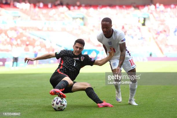Josip Brekalo of Croatia stretches for the ball whilst under pressure from Raheem Sterling of England during the UEFA Euro 2020 Championship Group D...
