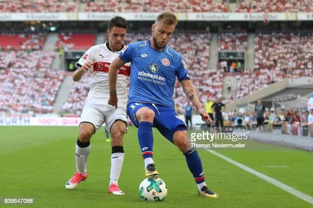 Josip Brekalo of Stuttgart fights for the ball with Alexandru Maxim of Mainz during the Bundesliga match between VfB Stuttgart and 1 FSV Mainz 05 at...
