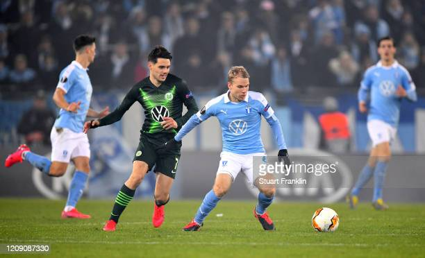 Josip Brekalo of VfL Wolfsburg battles for possession with Oscar Lewicki of Malmo FF during the UEFA Europa League round of 32 second leg match...